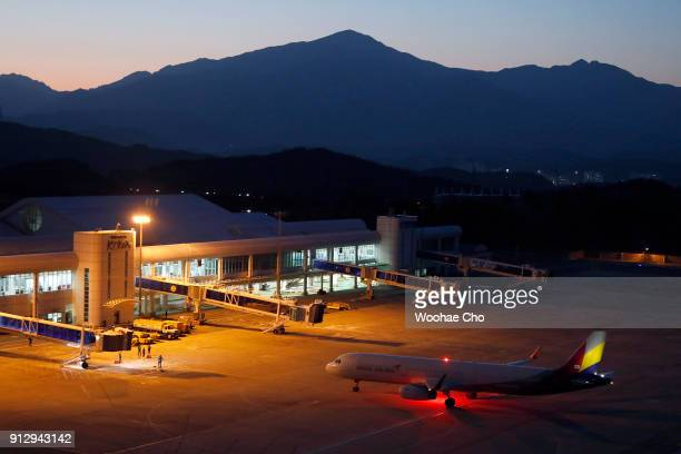 South Korean airline ASIANA flight with the North Korean athletes attending the PyeongChang 2018 lands at Yangyang airport on February 1 2018 located...
