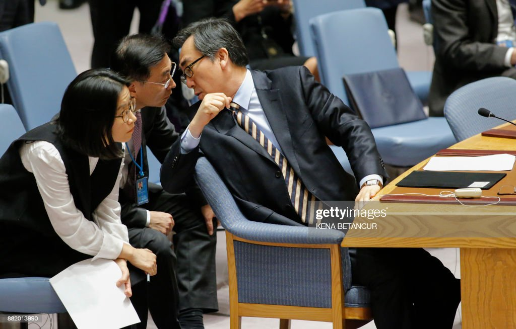 South Korean Ambassador to the United Nations Cho Tae-yul speaks with team members before a UN Security Council emergency meeting over the launch of another ballistic missile by North Korea on November 29, 2017, at UN Headquarters in New York. /