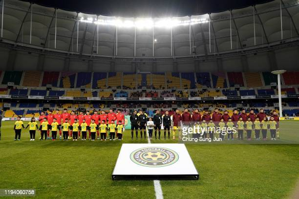 South Korean and Chinese team line up during the EAFF E-1 Football Championship match between South Korea and China at Busan Asiad Main Stadium on...