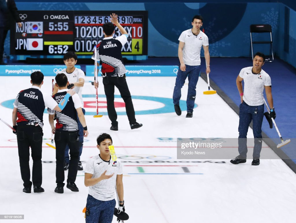 South Korean and Japanese (white) curling team members react after South Korea's 10-4 victory in a men's round-robin session match at the Pyeongchang Winter Olympics in Gangneung, South Korea, on Feb. 21, 2018. Japan failed to win a spot in the semifinals. ==Kyodo