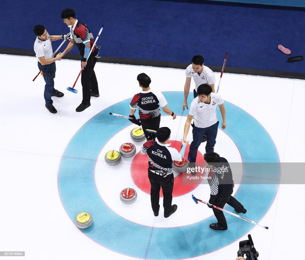 South Korean and Japanese (white) curling team members shake hands after South Korea's 10-4 victory in a men's round-robin session match at the Pyeongchang Winter Olympics in Gangneung, South Korea, on Feb. 21, 2018. Japan failed to win a spot in the semifinals. ==Kyodo