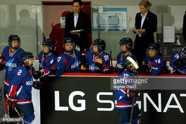South Korean and North Korean athletes celebrate during the Women's Ice Hockey friendly match at Seonhak International Ice Rink on February 4 2018 in...