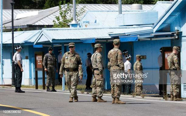 South Korean and US Army soldiers stand guard at the border village of Panmunjom in the Demilitarized Zone on September 7 2018 The leaders of the two...