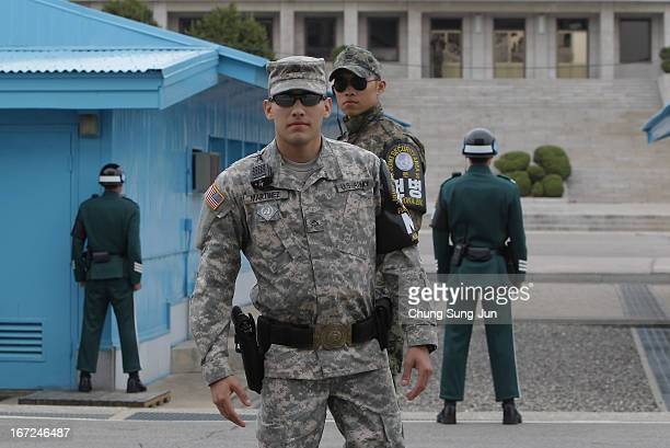 South Korean and US soldiers stand guard at the border village of Panmunjom between South and North Korea at the Demilitarized Zone on April 23 2013...