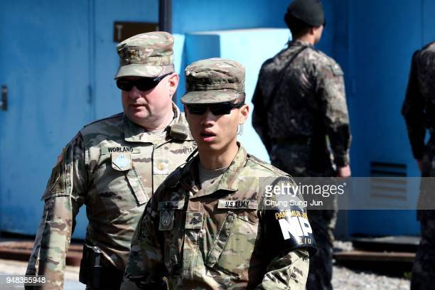 South Korean and US soldiers stand guard at the border village of Panmunjom between South and North Korea at the Demilitarized Zone on April 18 2018...