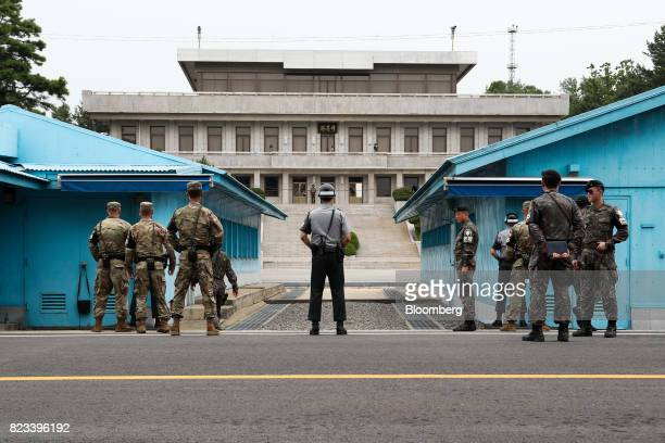 South Korean and US soldiers stand guard next to United Nations Command Military Armistice Commission conference buildings at the truce village of...