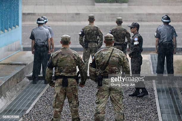 South Korean and US soldiers stand guards during an event to commemorate the 63rd Anniversary of the Korean War Armistice Agreement in the the Joint...