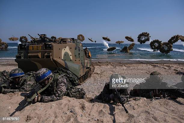 TOPSHOT South Korean and US soldiers take a position during an annual joint military landing exercise in Pohang on South Korea's southeast coast on...