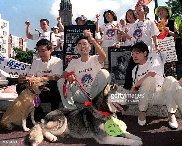 South Korean animal welfare activists rally in front of Myongdong Cathedral in Seoul 16 August 1999 to press their demand for a ban on edible dog...