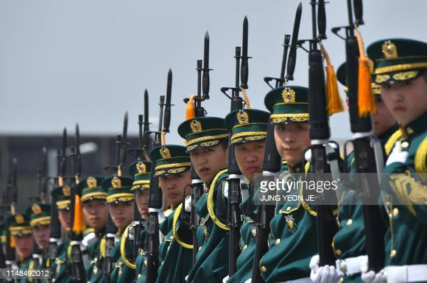 South Korean Army honour guards perform during a ceremony to commemorate the 75th anniversary of the Eighth US Army at Camp Humphreys in Pyeongtaek...