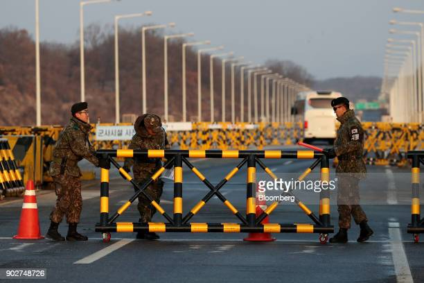 South Korean army soldier move a barricade at a military check point on the Unification Bridge linked to North Korea near the demilitarized zone at...