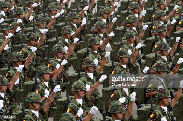 South Korean Army soldiers march during the 55th Armed Forces Day ceremony at the Sungnam military airport October 1 2003 in Sungnam South Korea...