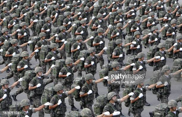 South Korean army soldiers march during the 65th South Korea Armed Forces Day ceremony at Seongnam Military Airbase on October 1 2013 in Seongnam...
