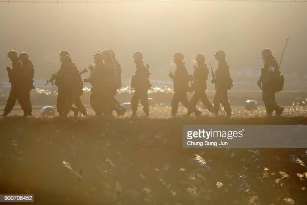 South Korean army soldiers patrol near the demilitarized zone of Panmunjom on January 3 2018 in Paju South Korea North Korean media has reported that...