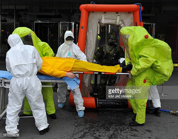South Korean army soldiers rescue civilian victims during a chemical warfare drill outside a hotel in Seoul on May 28 2010 Japan slapped new...