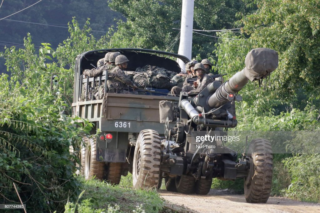 """South Korean army soldiers ride on the back of a truck during an annual exercise in Paju, near the border with North Korea, South Korea, Tuesday, July 4, 2017. North Korea on Tuesday claimed it successfully test-launched its first intercontinental ballistic missile, a potential game-changing development in what may be the world's most dangerous nuclear standoff and, if true, a direct rebuke to U.S. President Donald Trump's earlier declaration that such a test """"won't happen!"""""""