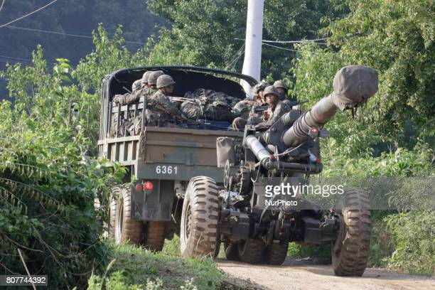 South Korean army soldiers ride on the back of a truck during an annual exercise in Paju near the border with North Korea South Korea Tuesday July 4...