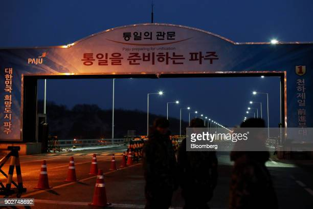 South Korean army soldiers stand guard at a military check point on the Unification Bridge linked to North Korea near the demilitarized zone at dawn...