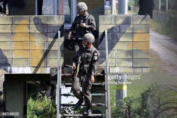 South Korean army soldiers stand guard at Imjingak Pavilion near the demilitarized zone of Panmunjom on September 15 2017 in Paju South Korea North...