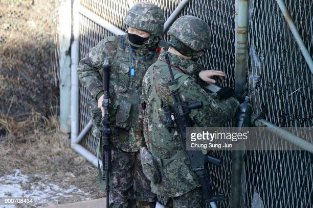 South Korean army soldiers stand guard at Imjingak Pavilion near the demilitarized zone of Panmunjom on January 3 2018 in Paju South Korea North...