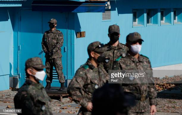 South Korean army soldiers stand guard during a reopening ceremony for border village of Panmunjom between South and North Korea in the demilitarized...