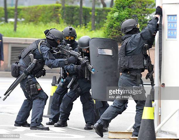 South Korean army special force soldiers take position during a chemical warfare drill outside a hotel in Seoul on May 28 2010 Japan slapped new...
