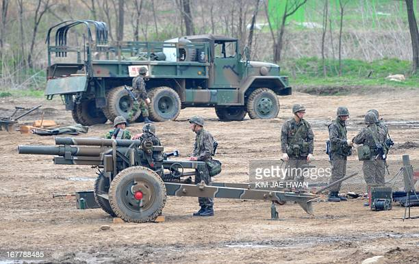 South Korean army take part in a drill with a 105mm howitzer near the border in Paju on April 30 2013 The United States and South Korea wrapped up...