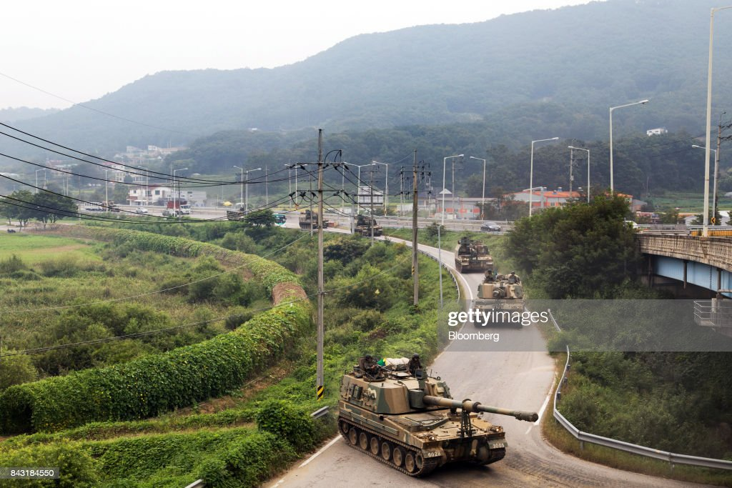 South Korean army tanks travel along a road near the border in Paju, South Korea, on Wednesday, Sept. 6, 2017. North Korean has beenseen readying another launchof an intercontinental ballistic missile that could come before it marks the anniversary of its founding on Sept. 9.Photographer: SeongJoon Cho/Bloomberg via Getty Images