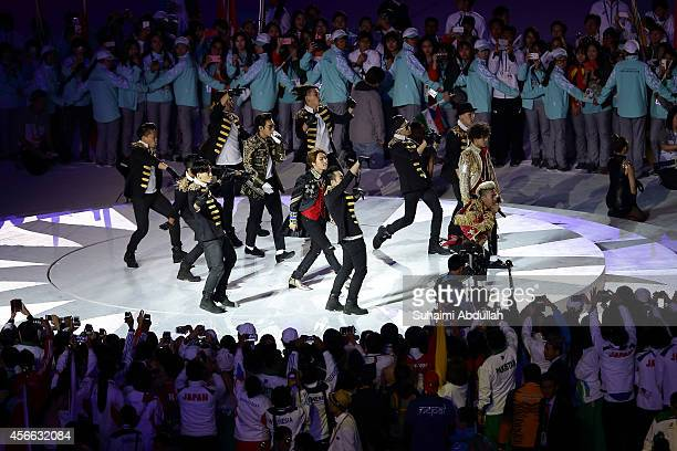 South Korean band Big Bang performs on stage during the closing ceremony on day fifteen of the 2014 Asian Games at Incheon Asiad Main Stadium on...
