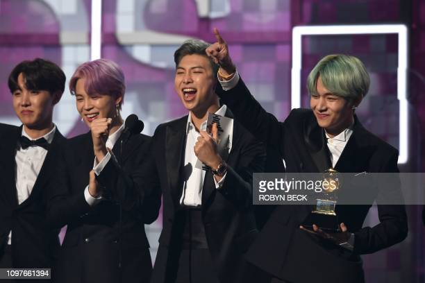 South Korean band BTS presents the award for Best RB Album during the 61st Annual Grammy Awards on February 10 in Los Angeles
