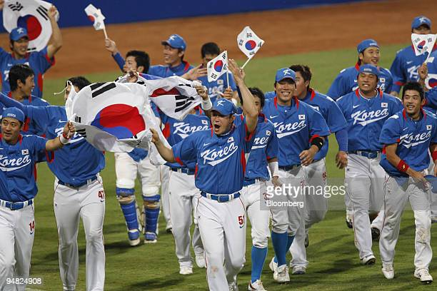 South Korean baseball players celebrate their gold medal victory in baseball on day 15 of the 2008 Beijing Olympics in Beijing China on Saturday Aug...