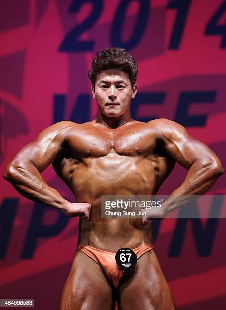 South Korean bodybuilder Hong EuiSun performs in the WFF Men Class One competition during the 2014 NABBA/WFF Korea Championship on April 13 2014 in...