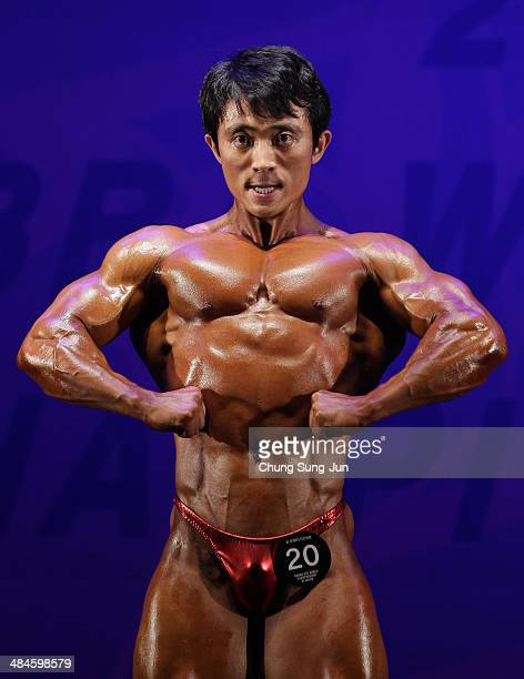 South Korean bodybuilder Kim DongWoon performs in the WFF Overall competition during the 2014 NABBA/WFF Korea Championship on April 13 2014 in Daegu...