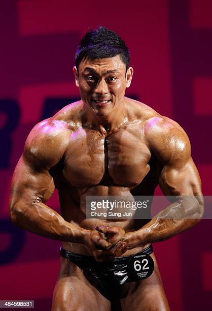 South Korean bodybuilder Kim MyungJoon perform in the WFF Overall competition during the 2014 NABBA/WFF Korea Championship on April 13 2014 in Daegu...
