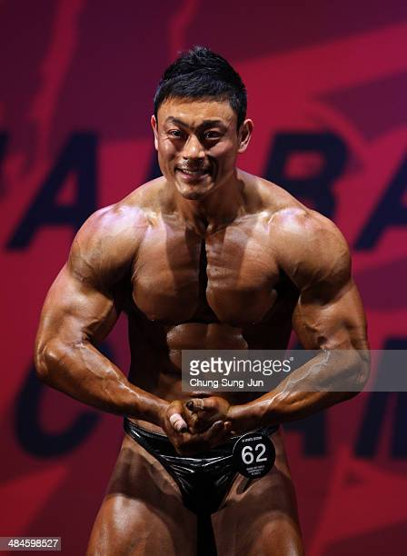 South Korean bodybuilder Kim MyungJoon performs in the WFF Men Class One competition during the 2014 NABBA/WFF Korea Championship on April 13 2014 in...
