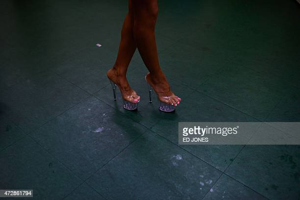 A South Korean bodybuilder waits backstage to compete in the 'Miss Sport Model' category at the 2015 Muscle Pump NABBA WFF Korea Championships in...