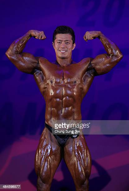 South Korean bodybuilder Yoo JoonSeok performs in the WFF Men Class Two competition during the 2014 NABBA/WFF Korea Championship on April 13 2014 in...