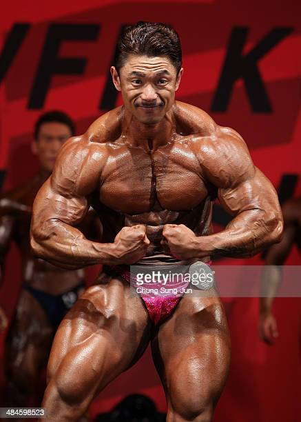South Korean bodybuilder Yoon JongMook performs in the WFF Men Class Three competition during the 2014 NABBA/WFF Korea Championship on April 13 2014...