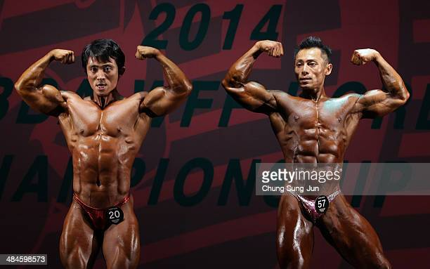 South Korean bodybuilders Kim DongWoon and Kwon YoungDoo perform in the WFF Overall competition during the 2014 NABBA/WFF Korea Championship on April...