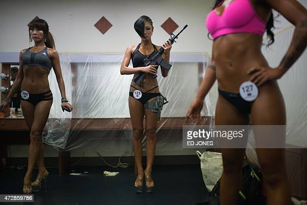 South Korean bodybuilders prepare backstage before competing in the 'Miss Sport Model' category at the 2015 Muscle Pump NABBA WFF Korea Championships...