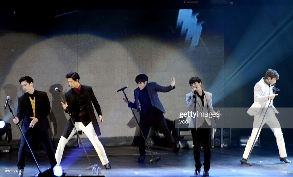 South Korean boy band 2PM perform on the stage in concert at Guangzhou Gymnasium on March 30, 2013 in Guangzhou, China.