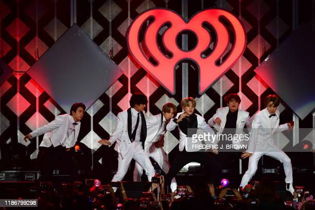 South Korean boy band BTS performs onstage during the KIIS FM's iHeartRadio Jingle Ball at the Forum Los Angeles in Inglewood, California on December...