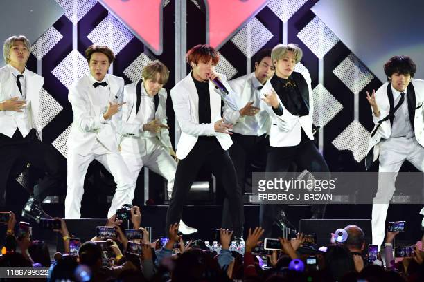 South Korean boy band BTS performs onstage during the KIIS FM's iHeartRadio Jingle Ball at the Forum Los Angeles in Inglewood California on December...