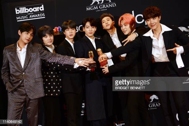 South Korean boy band BTS poses in the press room with their awards during the 2019 Billboard Music Awards at the MGM Grand Garden Arena on May 1 in...