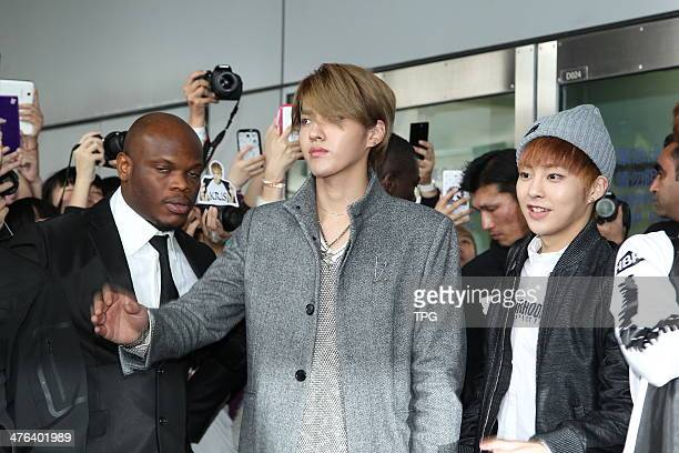 South Korean boy band EXOM arrive at the airport and hundreds of fans waiting for them outdoors on Saturday March 12014 in Hong KongChina