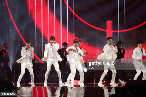 South Korean boy group Shinhwa perform onstage during their concert 2017 Shinhwa Live Unchanging In Taipei at Taipei Nangang Exhibition Center on...