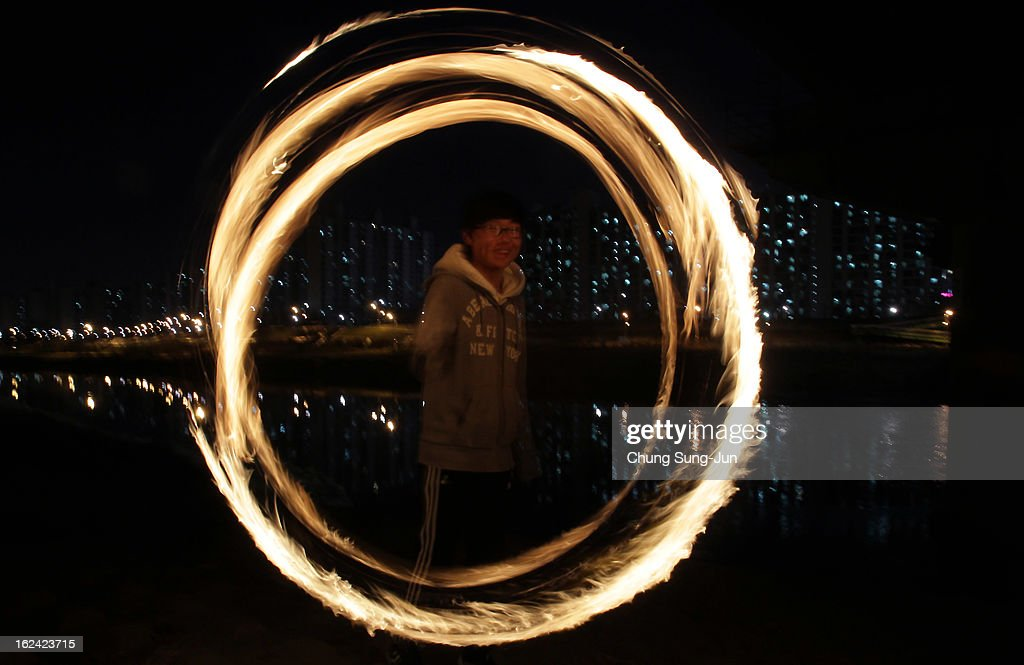A South Korean boy spins a fire can during 'Jwibulnoli' a South Korean folk game at Han River on February 23, 2012 in Seoul, South Korea. The event is part of a 'Daeboreum', a Korean holiday that celebrates the first full moon of the lunar new year.