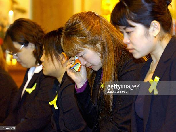 South Korean Buddhist fans shed tears during a memorial for canto pop singer and actor Leslie Cheung at the Bongun Temple in Seoul 28 March 2004...