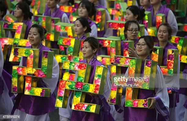 South Korean Buddhists carry colorful lanterns as they celebrate the forthcoming birthday of Buddha on May 16, 2015 in Seoul, South Korea. As the...