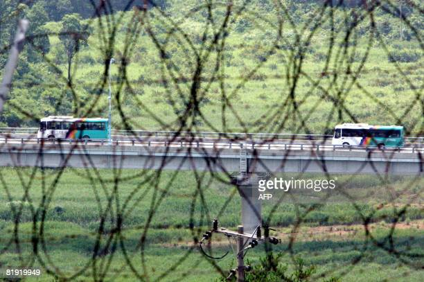 South Korean buses are seen transporting tourists near the border in Goseong east of Seoul from the North's Kumgang resort on July 13 2008 They...